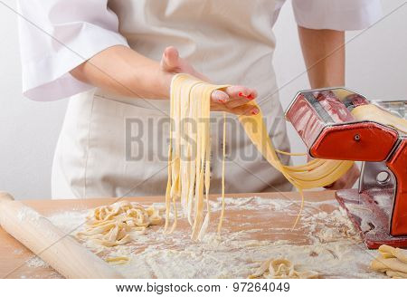Young Woman Chef Prepares Homemade Pasta
