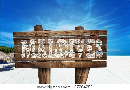 Maldives wooden sign on the beach