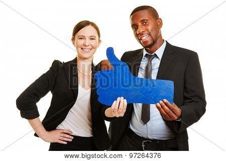 Man and woman holding blue thumbs up as sign for social networks