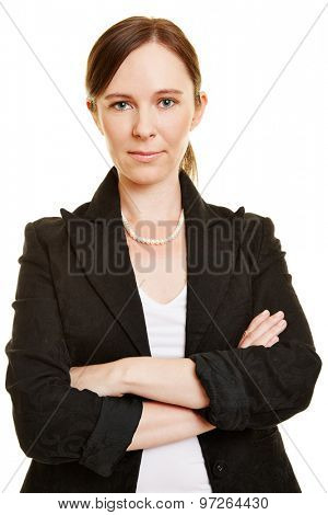 Attractive business woman looking confident with her arms crossed