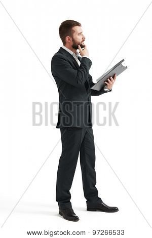 thoughtful businessman with black folder looking forward. isolated on white background
