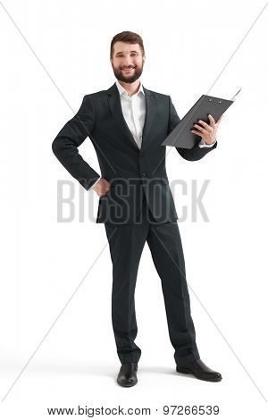 cheerful businessman holding black folder and looking at camera. isolated on white background