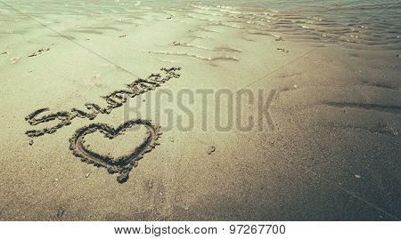 written text in the sand on the beach