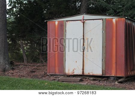 Rusted metal shed