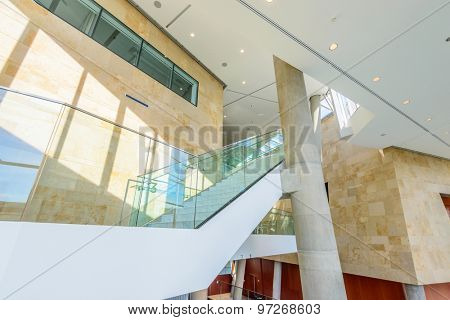 White staircase. Abstract fragment of the architecture of modern lobby, hallway of the luxury hotel, shopping mall, business center in Vancouver, Canada. Interior design.