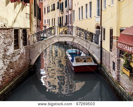 Narrow Canal Among Old Houses In Venice