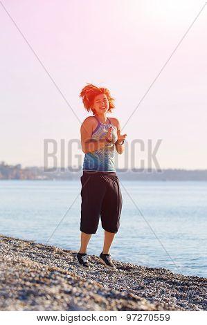 girl plays on the sea beach