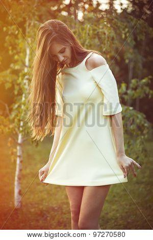 beautiful young woman in cute short dress in park retro colors