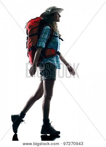 one caucasian woman trekker trekking walking nature in silhouette isolated on white background