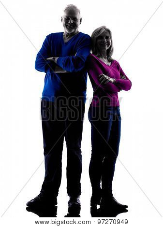 one caucasian couple senior standing  silhouette  in silhouette studio isolated on white background