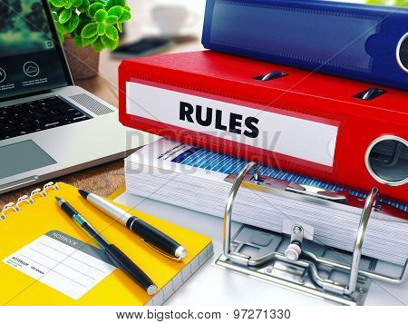 Rules on Red Ring Binder. Blurred, Toned Image.