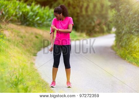 African American Woman Runner Attaching Music Armband - Fitness, People And Healthy Lifestyle