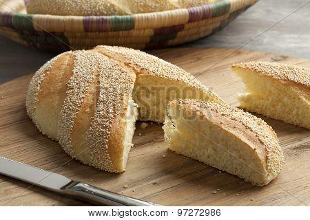Fresh baked Moroccan semolina bread cut into pieces
