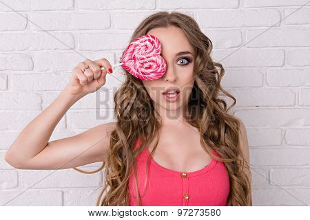 Pretty Girl Closed Her Eyes Candy. Beautiful Girl Licking A Pink Lollipop. Girl Has A Very Long Hair