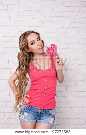 Girl Licking A Pink Lollipop