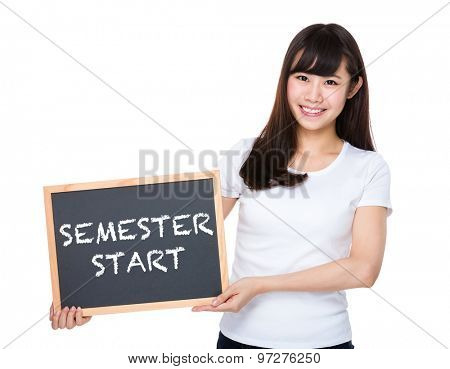Woman hold with chalkboard showing semester start