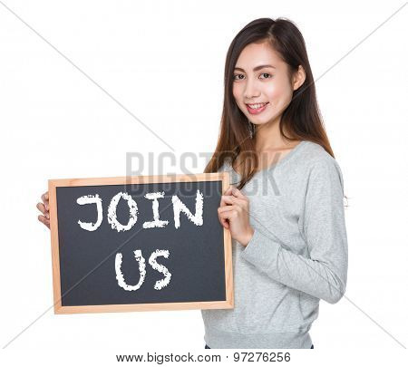 Pretty woman hold with blackboard and showing phrase of join us