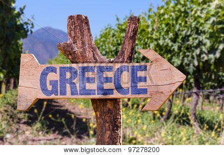 Greece wooden sign with winery background