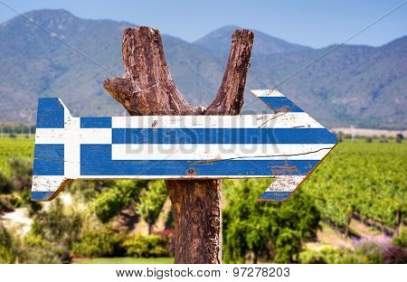 Greece Flag wooden sign with winery background