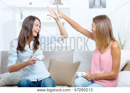 Two women having fun playing video games