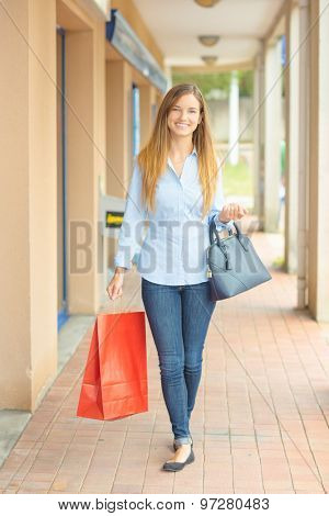 Woman having a successful shopping trip