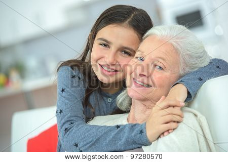 Hugging her grandma