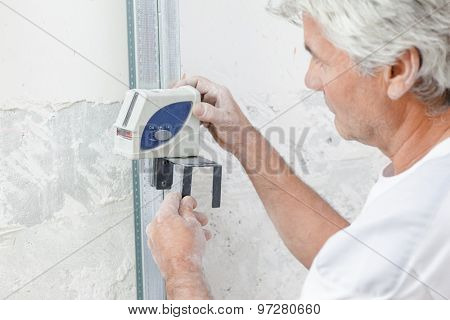 Taking a measurement of an unfinished wall