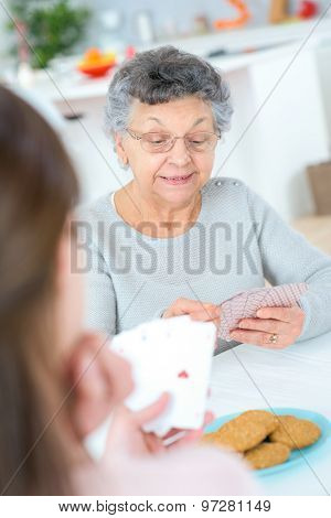 Playing cards with her grandma