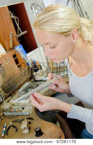 Jeweller in her workshop