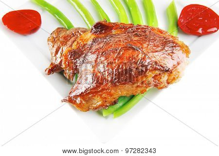 roast meat served with beans on white dish