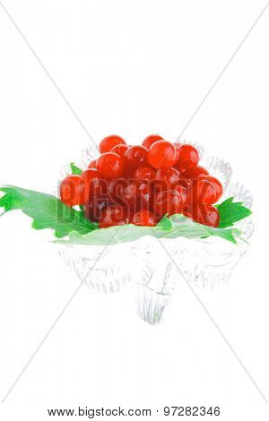 image of wild berry on transparent glass over white