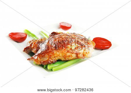 roasted meat served with beans on ceramic plate