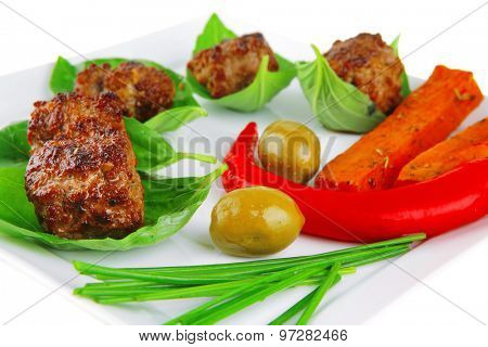 small french beef cutlets on basil with potatoes