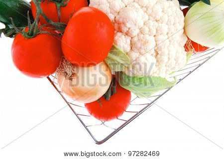 vegetables in metal store basket on white background