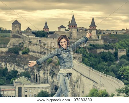 Portrait of young woman  on the background of an old fortress in Kamenetz-Podolsk