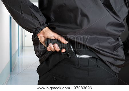Bodyguard Removing Handgun