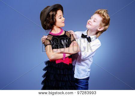 Two modern kids posing together. Fashion shot.