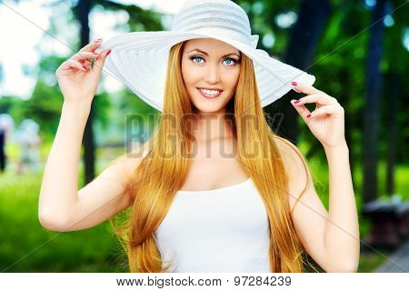 Happy elegant young woman with beautiful smile outdoors. Beauty, fashion. Summer vacation.