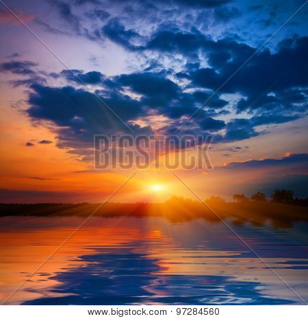 Majestic sunset over lake water