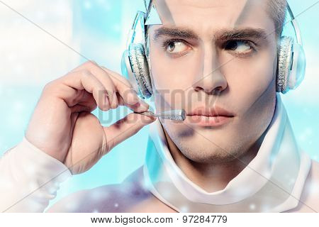Close-up portrait of a handsome man with futuristic make-up and hairstyle standing on a luminous transparent background. Technologies of the future.