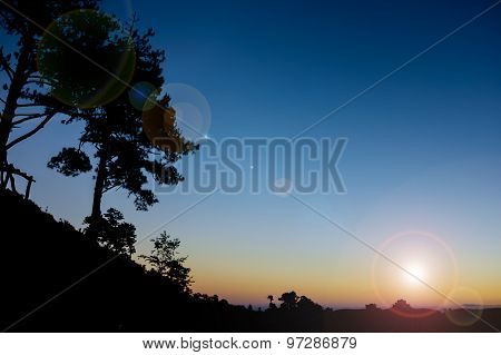 Silhouetted Mountain With Blue Sky