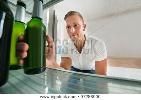 Man Taking Beer From A Refrigerator