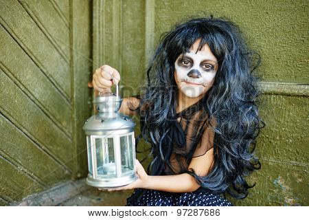 Happy Halloween girl in wig holding lantern