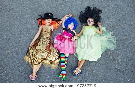 Group of relaxed girls in Halloween attire