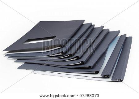 Pile of folders on plain background