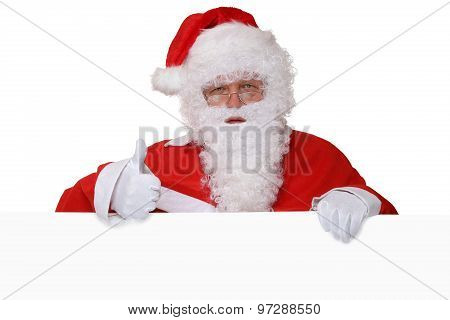 Santa Claus Showing Thumbs Up On Christmas With Empty Banner And Copyspace