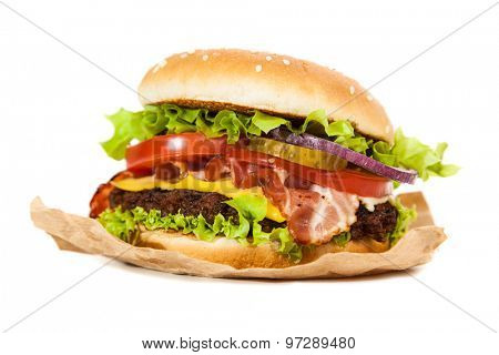 Delicious hamburgers on wooden background