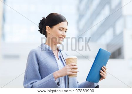 business, technology and people concept - young smiling woman with tablet pc computer over office building