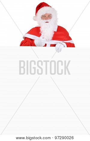 Santa Claus Thumbs Up On Christmas With Empty Banner And Copyspace