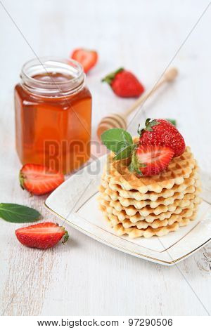 Jar Of Honey, Ripe Strawberries And Waffles.